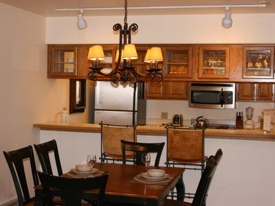 Dining table, bar and kitchen