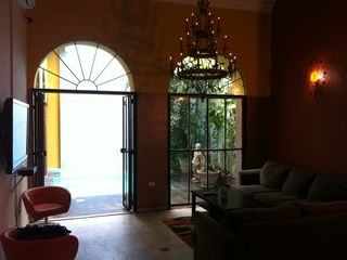 San Juan villa photo - Living Room, flat tv, warm antique chandelier & sunlight wall sconces