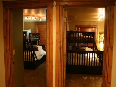 The two adjacent bunk rooms - each has a twin-over-full bunk bed + trundle bed