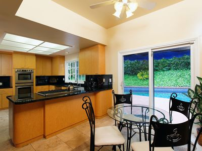 Fully stocked eat-in kitchen with high end appliances and flat screen TV