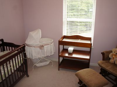 Nursery in the master bedroom for worry free travel.