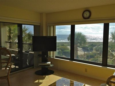 Behind the big screen HDTV is a large and welcoming oceanfront verandah.