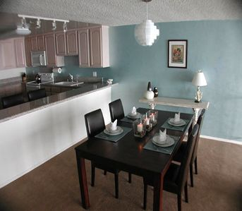 The spacious kitchen and dining room have spectacular ocean views