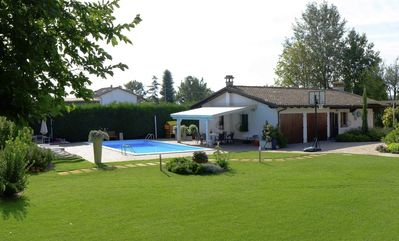 Country house surrounded by gardens and swimming pool