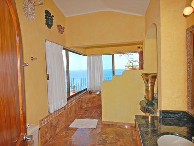 Puerto Vallarta condo rental - The Master Bath Looks Out To The Ocean From Its Private Shower Picture Windows..