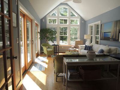 Bright sun room open to very private deck