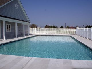 Vacation Homes in Ocean City townhome photo - Community Pool and Gym