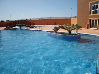 Huge communal pool, also shallow kids pool