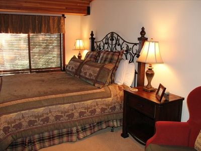 """Lodge Master Suite"" with king size bed, view of lake thru trees."