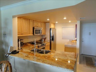 Updated fully equipped kitchen wood cabinets, ss appliances, granite countertops