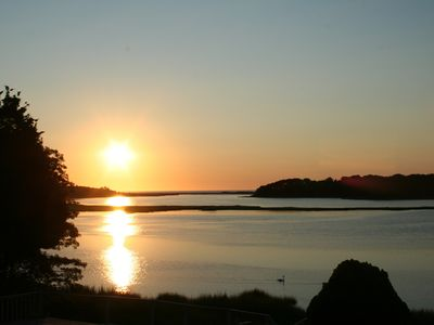 Watch the swans glide as the sun rises over Nauset Beach on Cape Cod.