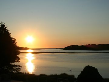 Orleans house rental - The Sun rises over Bluewaters as the swans glide on Pochet inlet.