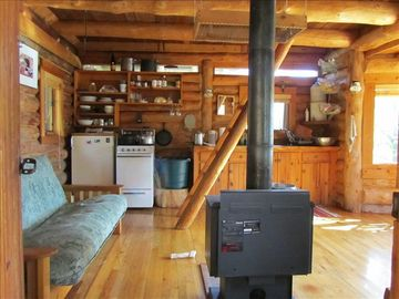 interior view with ladder to upstairs sleeping loft