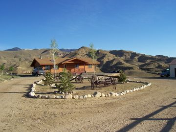 Cody chateau / country house rental - Front of the Cabin, with the Bear Tooth Mountains in the back ground.