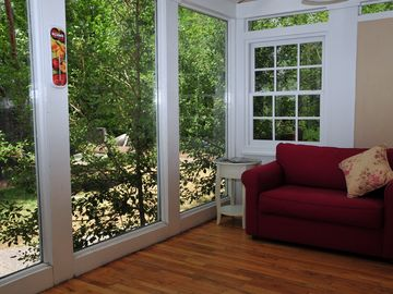 Relax in the Sunroom with a book and glass of ice tea