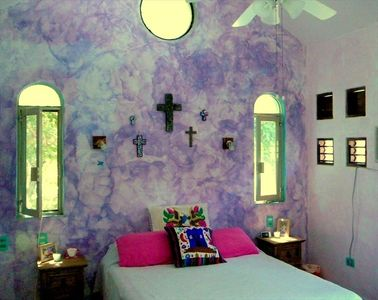 "The ""Artista"" room is colorful and cozy with queen bed, A/C, and private bath"