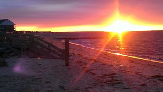 Yarmouth cottage photo - Sunrise from our beach, steps lead over our Seawall to more private sandy beach