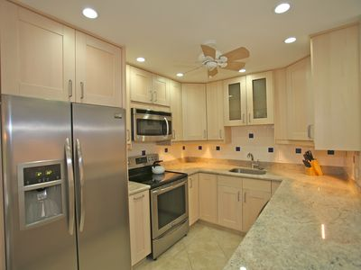kitchen stainless steel appliances granite counter tops ceiling
