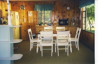 Enjoy breakfast and the view. - Walloon Lake cottage vacation rental photo
