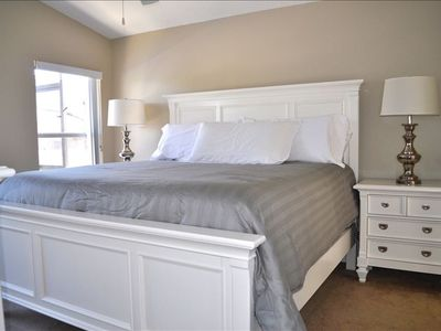 Master Suite with King Sized Bed, Attached Bathroom and views of Pool and Pond!