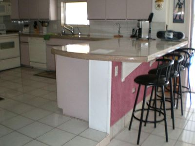Kitchen counter with bar stools  (4 stools)