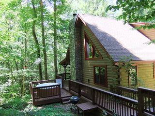 Maggie Valley cabin photo - Side view of the cabin with Hot Tub and Grill.