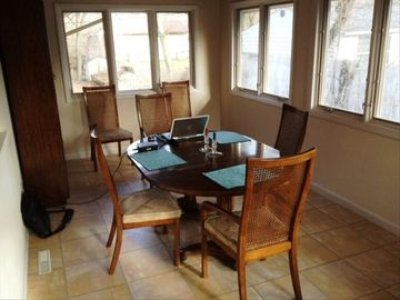 Wonderful sunny dining room with windows on 3 sides.
