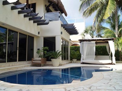 beautiful ground floor swimming pool with sun beds