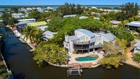 spectacular vacation property close to beach w/private heated pool & boat lift