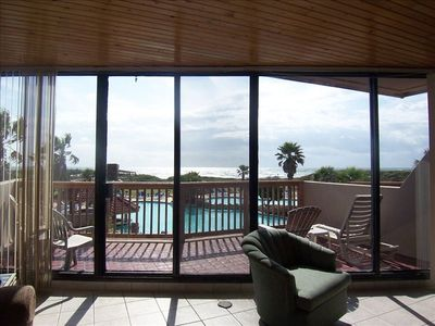 View from Our Living, Dining, Kitchen areas looks out to pool & Gulf waters