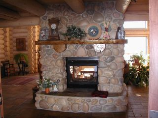 Snowbasin estate photo - Entry fireplace