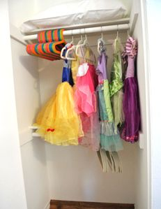 Kids closet with princess dresses and newly added dress-up clothes for boys, too