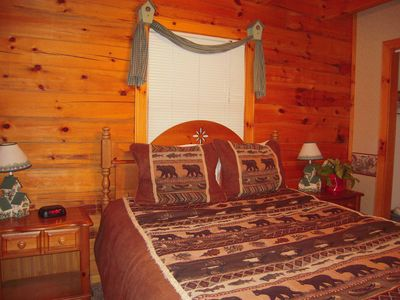 A QUEEN BEDROOM downstairs in this easy to enter log cabin with second TV