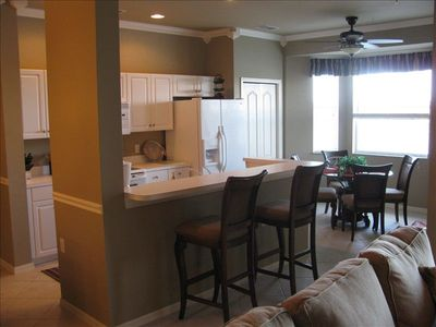 Fully equipped kitchen and the breakfast nook overlooking the lake.