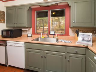 Quechee house photo - Kitchen with refrigerator, stove, oven, microwave, trash disposal, dishwasher