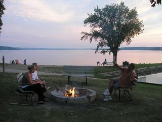 Lake Leelanau cottage photo - Bonfire right in front of cottage - beach in background