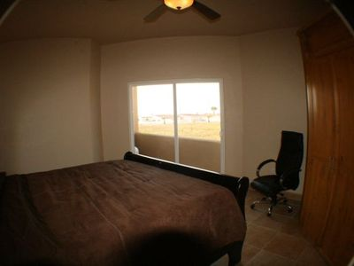 Bathroom 3 located downstairs with King Bed, fan Ocean View and access to beach.