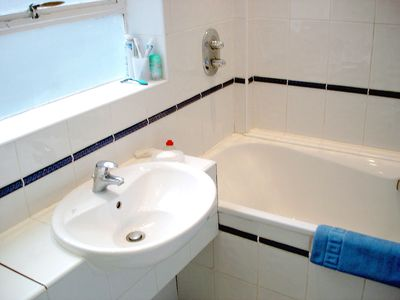 THE BATHROOM with a king size bath and a modern wall mounted toilet.