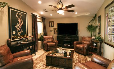 "Media Room, N. Side- 55"" High Definition TV w/ Surround Sound & Reclining Chairs"