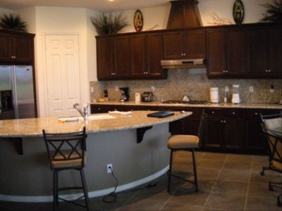 Fully equipped kitchen, granite countertops, and stainless steel appliances