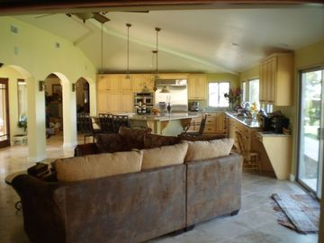 Remodeled kitchen and family room with fireplace.