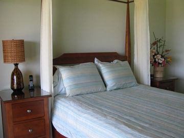 This guest bedroom also opens to the upper lanai and fabulous views.