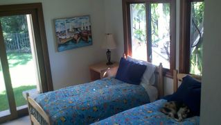 Tiburon house photo - Downstairs bedroom with 2 twin beds, can be config as king bed. Slider to lawn