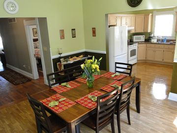 Manhattan cottage rental - View of the dining room, kitchen and hall with a glimpse of the second bedroom