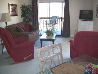 Branson condo photo - Dining area to Liv Room New Sofa Sleeper -2 comfy recliners -walk out to deck