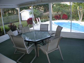Clearwater Beach house photo - Screened patio area overlooking covered pool in the cooler months