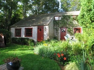 "A Captain's ""saltbox"" cottage nestled in the gardens"