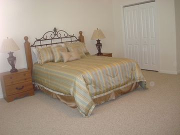 large queen bedroom with private bathroom