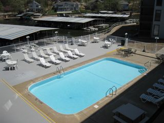 Osage Beach condo photo - Lakefront pool with plenty of seating.