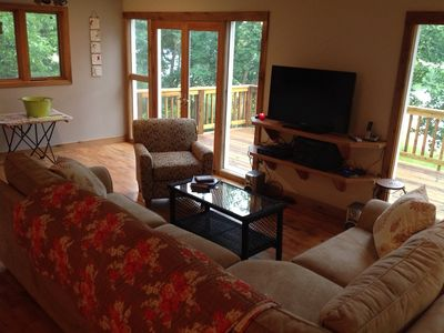 Living Room has lake views, TV, DVD player, wireless internet router, phone.